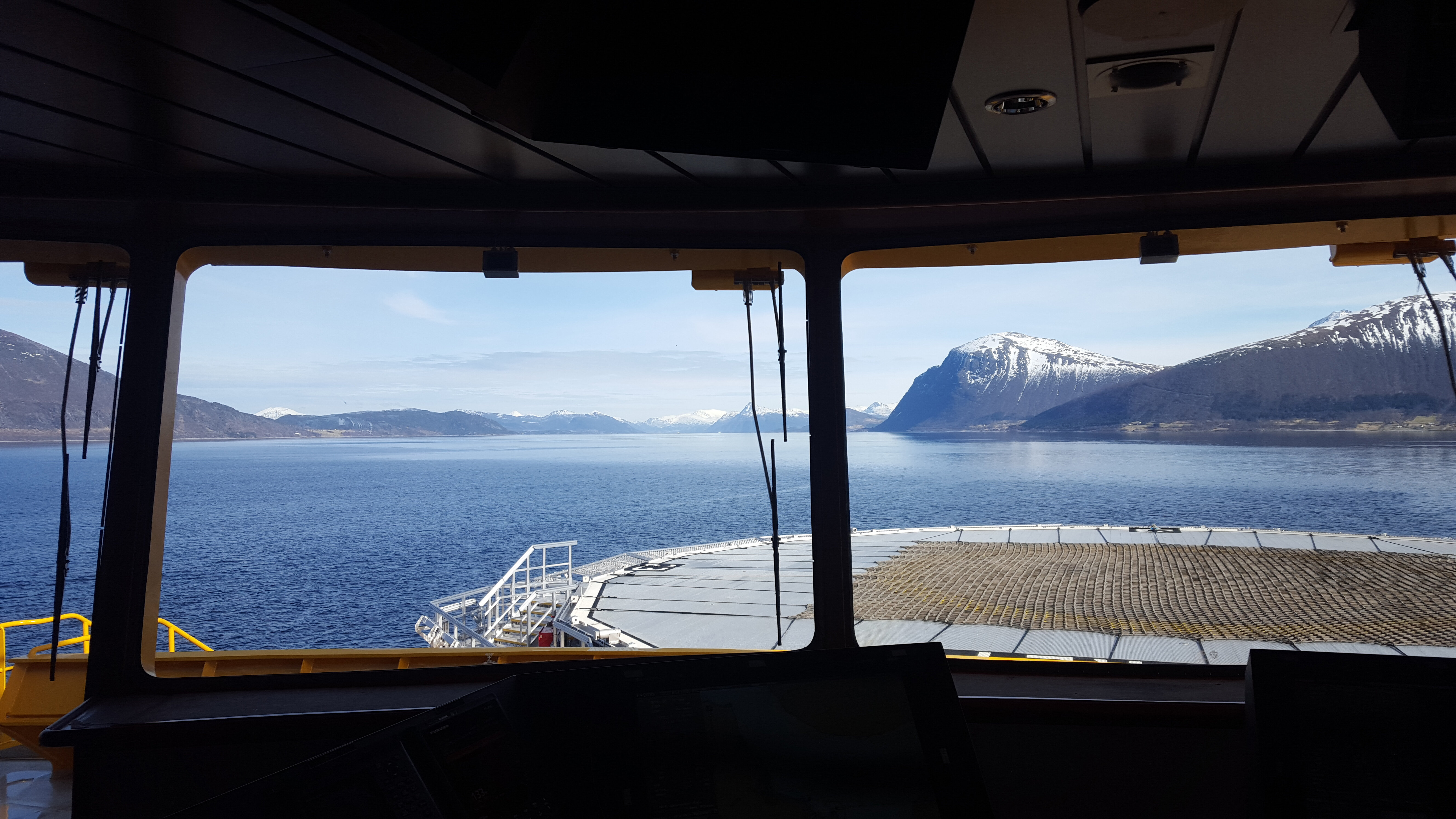 View from shop control room, fjord and snow-covered mountains